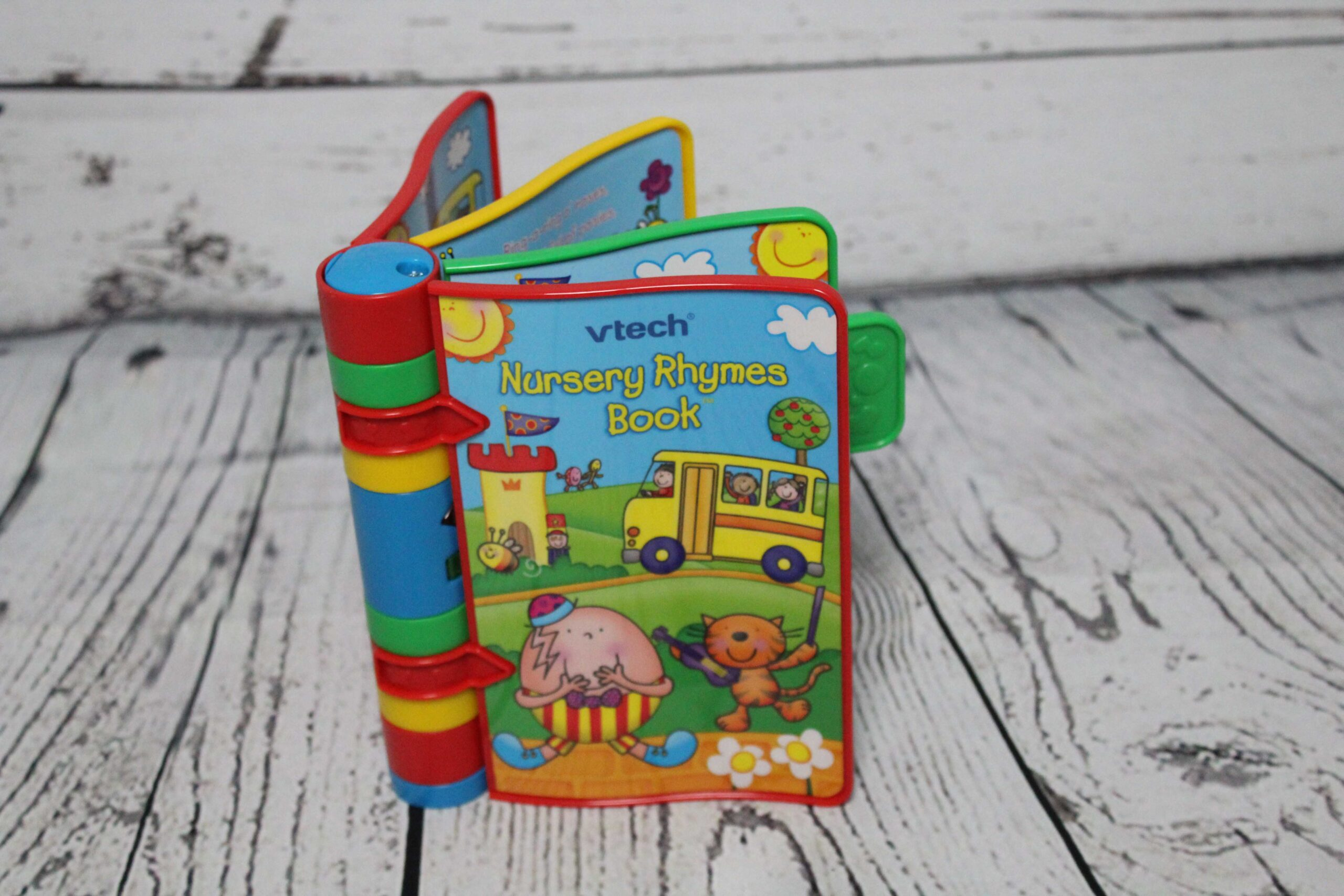 A colourful childrens book on a wooden background