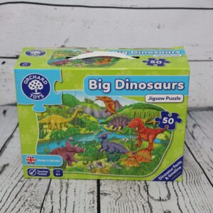 a green box showing a puzzle with dinosaurs on it