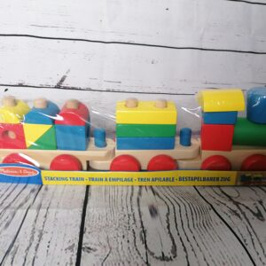 A picture of a colourful train made of wooden blocks
