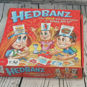 A picture of a red box on grey background, box shows 3 children playing a game
